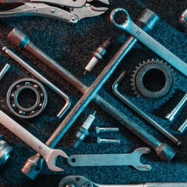 Bearings, wrenches, bolts on a dark background. view from above. Flat design. Automotive subjects.
