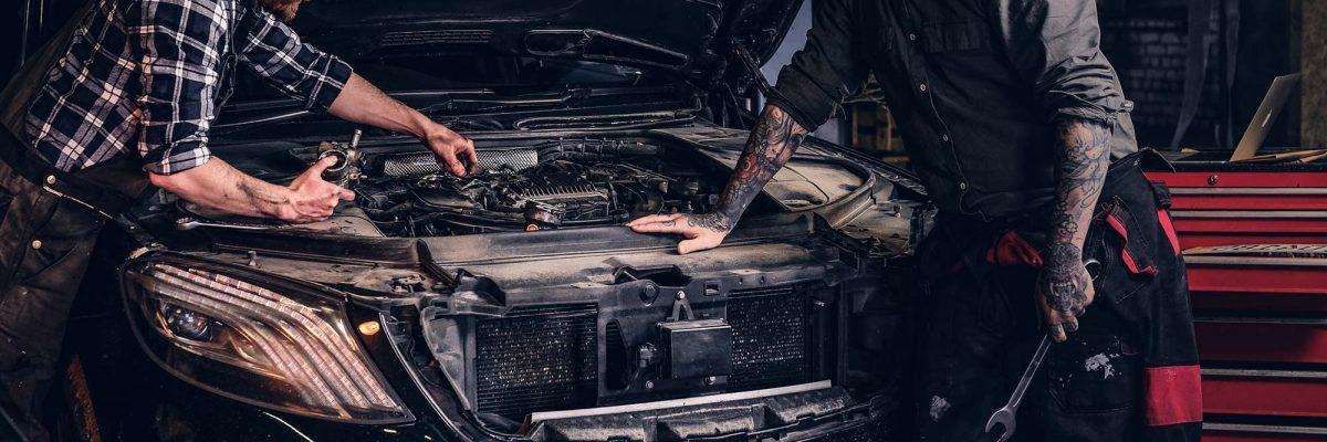 two-bearded-auto-mechanic-working-in-repair-garage-small.jpg